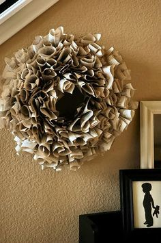 Book pages wreath made with actual pages torn from a book. I am totally making this!!