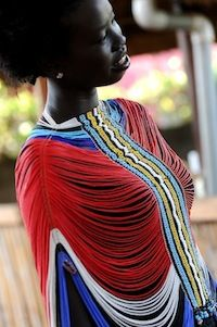 Africa |  Traditional Dinka Beaded Corsets.  This one has been made by Mary Padar who is able to sell them through the Roots project which enables her to support her family and send her many grandchildren to school. | © www.FolkArtMarket.org