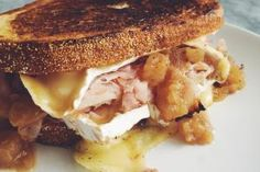 When the days start to get shorter and our shadows start to get longer, it's not surprising that we crave warm and toasty sandwiches to help warm our souls!: Ham and Brie Grilled Cheese with Caramelized Onion and Apple Spread