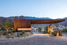Posted outside a Palm Springs community, the Desert Palisades Guardhouse looks more like one of the new residences than staff quarters. The building is suited for its desert environment with a weathered steel facade. Its rusty hue compliments the surrounding...