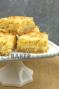 These coconut bars are rich and sinful, but they use ingredients that you likely have on hand Coconut Squares Recipe, Coconut Bars, Coconut Recipes, Lemon Coconut, Easy Snacks, Easy Desserts, Delicious Desserts, Keto Snacks, Easy Cookie Recipes