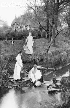 Women Drawing Water from Stream...Shottery Brook, Shottery. Stratford-upon-Avon, Warwickshire, England, UK. 1890.