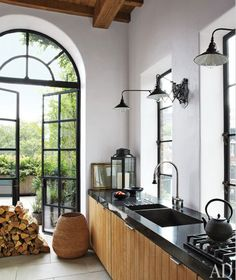 [Photos by Miguel Flores-Vianna for Architectural Digest.] In the April issue of Architectural Digest, Brad Goldfarb writes about the East Village duplex penthouse he shares with Alfredo Paredes,. Kitchen Interior, Black Kitchens, Interior, New York City Apartment, Home Decor, House Interior, Home Kitchens, Architectural Digest, Black Countertops