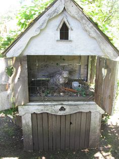 shabby rabbit hutch with concrete rabbit  Think my hubbie needs to build one of my stone rabbits a new home.