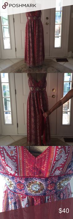 Michelle Antionelli Dress Red patterned Michelle Antonelli dress. Side zipper. Size 12 - fits like a size 10. Has a slit in the front of the dress from knee length to the bottom. Never worn - still has tags.  ❤️❤️ALL OFFERS ARE CONSIDERED! ❤️❤️LEAVE A COMMENT IF YOU HAVE QUESTIONS!  ❤️❤️NO TRADES Dresses Maxi