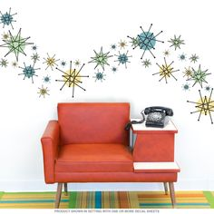 Retro wall decals featuring Atomic Age starbursts. Made in USA. 24 peel and stick wall stickers are easy to apply. They adhere to most any flat surface and give instant vintage appeal to a kitchen or dining room. Polyester fabric decals with a matte finish. Shapes range 1.75