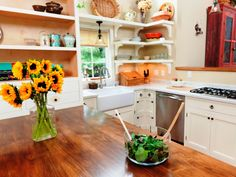 Not all surfaces have to be the same. Wood countertops are reasonably priced, easy to install and can add a ton of character. Replace a small standalone prep area or do the whole kitchen.