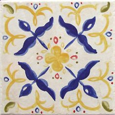 Lovely Spanish Tile In Yellow Blue Pink and White.
