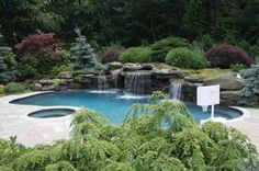 Great View Of Landscaping Around This Pool Notice The Basketball Hoop On The Right