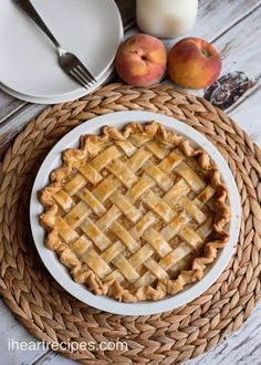"""Old fashioned peach pie made with canned peaches, and topped with crust! This post was brought to you on """"bee-half"""" of Feed a Bee, an initiative of the Bayer Bee Care Program. I was compensated in exchange for creating this recipe. Hey y'all! I'm back with an amazing dessert recipe. I you've been hanging with me for a while, you know how much I love cobblers. I mean, I have about three different peach cobbler recipes posted here on my blog. It was just a matter of time b..."""