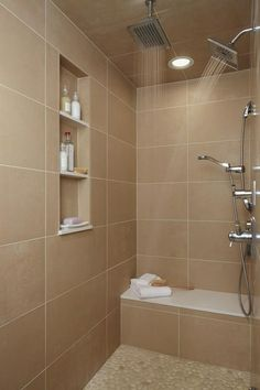 I like the shelf built in, the shower bench, and the rainfall shower head. Would definitely want 2 shower heads and minimal step in. Helping to plan a home to stay in. Would need prettier tile though