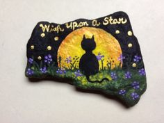 Black Cat - Wish Upon A Star painted rock by Phyllis Plassmeyer