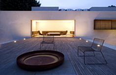 timber deck with paved fire bowl Chimney House | Marcio Kogan