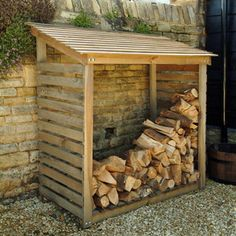 Wooden Log Store at STORE. Rustic pine log store for storing firewood in the garden or backyard. Outdoor Firewood Rack, Firewood Shed, Firewood Storage, Log Shed, Bike Shed, Wooden Storage Sheds, Shed Storage, Storage Ideas, Storage Rack