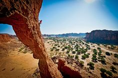 James Pearson making the sketchy first ascent of the Arch of Bishekele in Chad's Ennedi Desert.