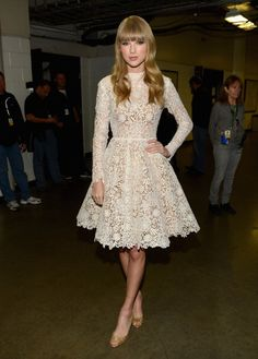 Taylor Swift's White longsleeve lace/crochet dress at the Grammy Nomination Concert.  Outfit details: http://wwtaylorw.com/2401/