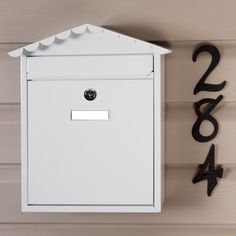 Visit Locking Wall Mount Mailbox - White Powder Coat by Maycreek. $29.95. This Visit Locking Wall Mount Mailbox has soft, decorative curves leading to the peak of its roof. Add security and beauty to your entryway with this powder coated mailbox, which is also available in Stainless Steel. Made of galvanized steel to resist corrosion with a powder coat finish. Overall dimensions: 11-7/8 L x 4-1/2 W (front to back) x 14 H (± 1/2 ). Letter slot dimensions: 8-5/8 ...