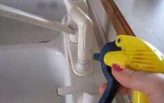 s the top 10 quick home repair tricks every homeowner should know, home decor, Spray hard water stains away with vinegar