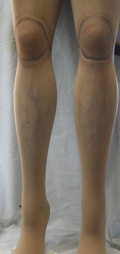 Tights with airbrushed ball knee joints for doll costumes.