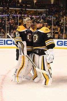 BOSTON, MA - MARCH 30: Tuukka Rask #40 and Anton Khudobin #40 of the Boston Bruins celebrate a win against the Dallas Stars at the TD Garden on March 30, 2017 in Boston, Massachusetts. (Photo by Steve Babineau/NHLI via Getty Images)