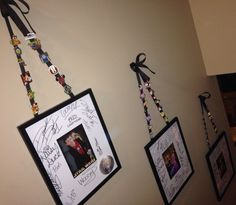 Disney Memory Wall. Have Disney characters sign photo frame matting. Then display with a Disney photo and hang by ribbon to display trading pins.