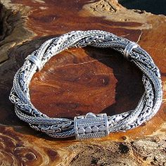 """""""Braided Twist"""" Bali Silver Bracelet - Four separate chains make up this eye-catching and intriguing bracelet. Two Byzantine (Borobudur) and two Wheat (Bunga Padi) styles are braided with two Sterling keepers to maintain the design. Bali Jewelry, Wire Jewelry, Pendant Jewelry, Jewelry Crafts, Jewelery, Handmade Jewelry, Jewelry Ideas, Wire Wrapped Earrings, Wire Earrings"""