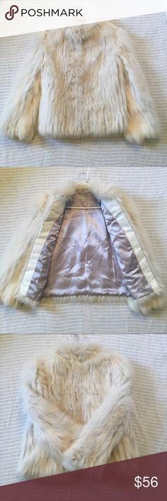 Faux Fur Coat Luxuriously soft material, great condition except the ripped tag on the inside. Clasps for closure, smooth lilac colored satin interior, convenient interior pocket. Very warm and sturdy coat. 🚫No Trades🚫 📦Fast Shipping📦 💸Offers Are Encouraged💸 🛍Happy Poshing🛍 Jackets & Coats