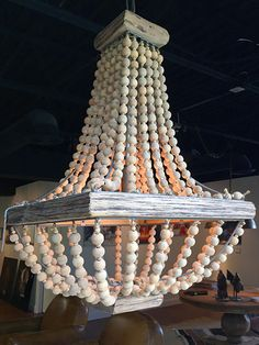 """This wooden chandelier from Vignette would look perfect in a beach house. """"Lamps & Lighting for Every Budget"""" from www.StyleBlueprint.com"""