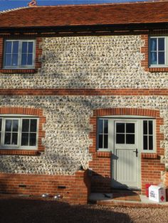 This country house in Edburton, Sussex was taken down and rebuilt. The original flints were saved and re-laid. Norfolk Country Cottages, Architecture Details, Landscape Architecture, Wall Design, House Design, Brick Walls, Brickwork, Stone Houses, Stone Work