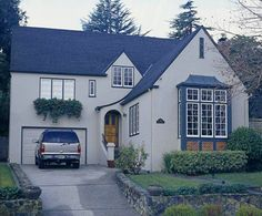 Love the tudor roof lines and arched front door