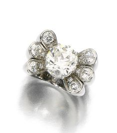 DIAMOND RING, RENÉ BOIVIN, 1933-1934. The central circular-cut diamond weighing 5.21 carats, set between fluted shoulders set with circular- and single-cut diamonds. French import marks.