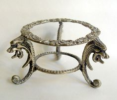 B8995 £SOLD (Oct 2013). A smallish vintage silver metal (probably oriental in origin and probably silver plated in some form) stand with dragon supports.