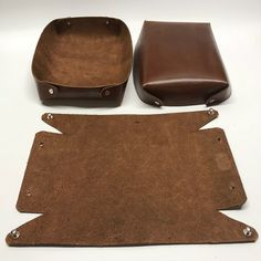 Three of our pack-flat Valet Trays headed out the door to a customer in NY. Our brown latigo leather valet tray is the perfect catch-all… Leather Tray, Leather Carving, Leather Gifts, Leather Bags Handmade, Leather Tooling, Leather Accessories, Leather Jewelry, Leather Restoration, Accessoires Barbie