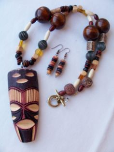 Long ebony rose wood stone beaded African tribal mask pendant necklace earring set - Tribal jewelry - African necklace - wood jewelry set. $15.99, via Etsy.