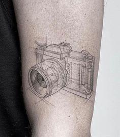 """THE ART OF TATTOOING on Instagram: """"Tattoo work by tattooist @daniel_berdiel ___ #finelinetattoo #cameratattoo #illustrationtattoo #lineworktattoo #smalltattoo…"""""""