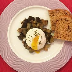 Uovo in camicia su letto di melanzane. Spicy Eggplant with Poached Eggs.  @thefeedfeed @official_italian_food  #lunch #poached #eggs #bread #spicy #eggplant #EggSmut #health #healthy #instagood #instamood #homemade #thephoneeatsfirst #heresmyfood #LikeFoodLA #snackcity #photooftheday #rome #italy #love #amazing #instadaily #food #yummy #foodblogfeed #foodphoto #foodporn #tasty #delicious #TGTBTF