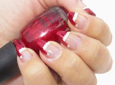 Red glittery Santa hat nails, never wanted stiletto nails so bad until now!