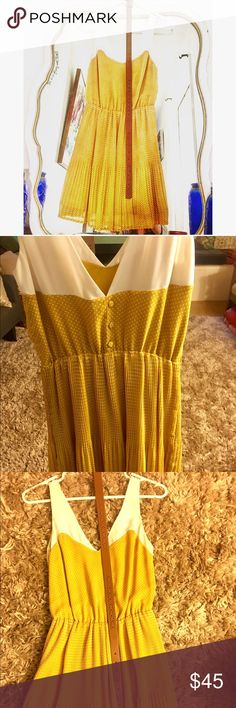 Adorable yellow and white dot sundress with belt! Lovely Ladakh dress and belt, new without tags. Dainty pleats at bottom and pretty button details on back. Make an offer! Ladakh Dresses