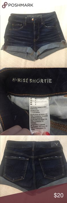 Hi-Rise Shortie AE Jeans, dark wash My favorite cut at AE! Lightly work but no signs of wear or fading. High-wasted—hits above the hips. Super comfy! American Eagle Outfitters Shorts Jean Shorts