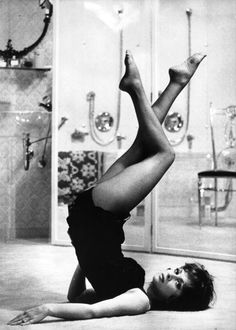Gina Lollobrigida with her legs in the air