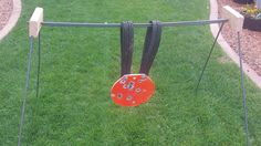 Steel target stand: 2x4 sections, some retread scraps from a highway, and some rebar. Use Grade 8 hardware.