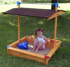 The canopy goes all the way down to cover the sand box... another great idea!