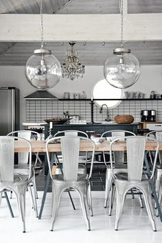Vintage industrial home in Falun with silver Tolix chairs in dining room. Via gallery2.blogspot.