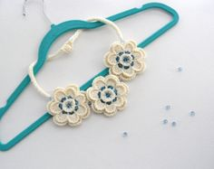 Hand crocheted with ivory acrylic yarn and finished with sky blue Swarovski Crystal Beads this Necklace Choker is light and comfortable to wear.