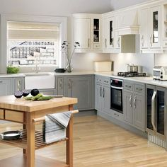 White Windsor L-Shaped Kitchen Finished in Deep Charcoal and Neutral Barley with Wood Flooring