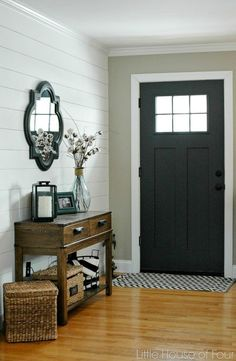 Black door and shiplap in the entryway, Fixer Upper style   100+ Beautiful Mudrooms and Entryways at Remodelaholic.com