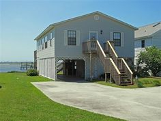 $449,000   175 SALTY SHORES POINT DR., NEWPORT NC  Waterfront home with dock and boat lift on Bogue Sound and the ICW With panoramic views this home features parking underneath with lots of storage an outside shower and an elevated rear deck. Inside you will find 3 bedrooms and 2 baths an open living area with wood flooring and numerous windows for natural light. Offered furnished with a few exceptions.