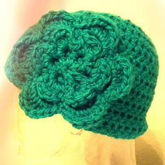 Green hat with attached flower