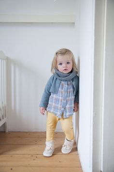 cute outfit for a toddler - plaid shirt, cropped cardigan, yellow pants, and high-top shoes
