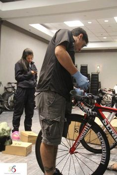 Colombian National Team crew members working on Stradalli Cycle Carbon Fiber Bikes to prepare for warm-ups for Richmond 2015 UCI Road World Championships